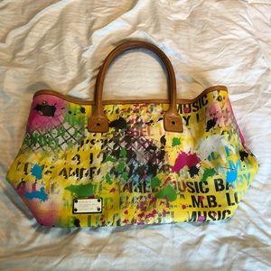Rare graffiti L.A.M.B. handbag by Gwen Stefani.